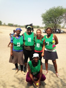 Members of the East Meets West netball team, with Masego and Hayley in the middle